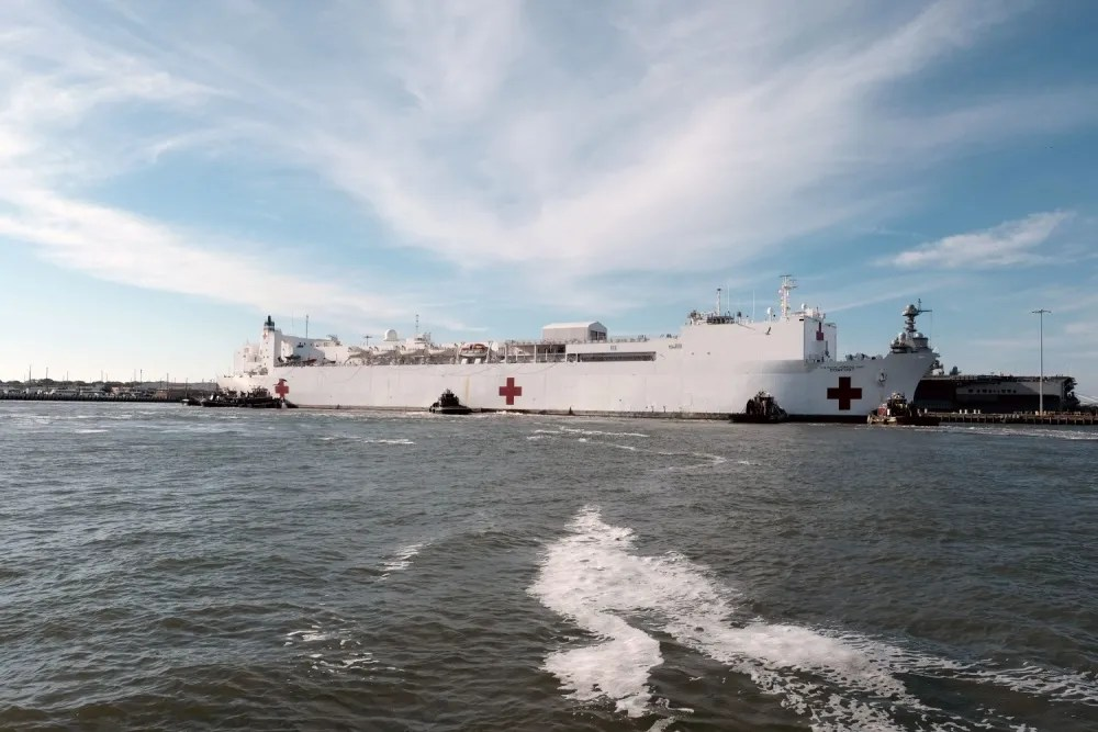 The hospital ship USNS Comfort (T-AH 20) returns to its homeport of Naval Station Norfolk after treating patients in New York and New Jersey in support of the COVID-19 pandemic. The ship and its embarked medical task force remain prepared for future tasking. The Navy, along with other U.S. Northern Command dedicated forces, remains engaged throughout the nation in support of the broader COVID-19 response. (U.S. Navy photo by Mass Communication Specialist 1st Class Joshua D. Sheppard/Released)