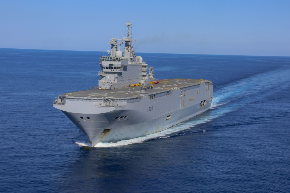 The French Navy amphibious assault ship Mistral sails in the vicinity of the amphibious assault ship USS Bataan (LHD 5) June 24, 2020. The Bataan is conducting operations in U.S. 6th Fleet in support of regional allies and partners, and U.S. national security interest in Europe and Africa. (U.S. Marine Corps photo by Cpl. Gary Jayne III/Released)