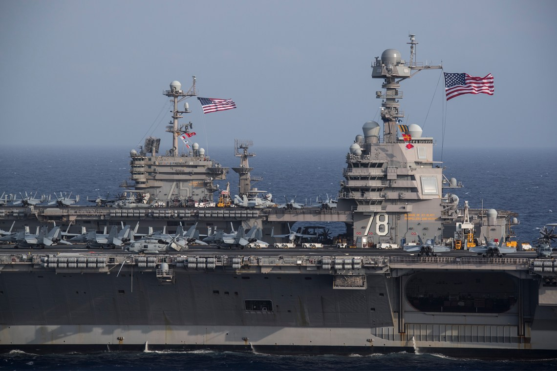 The Ford-class aircraft carrier USS Gerald R. Ford (CVN 78) and the Nimitz-class aircraft carrier USS Harry S. Truman (CVN 75) transit the Atlantic Ocean, June 4, 2020, marking the first time a Ford-class and a Nimitz-class aircraft carrier have operated together underway.