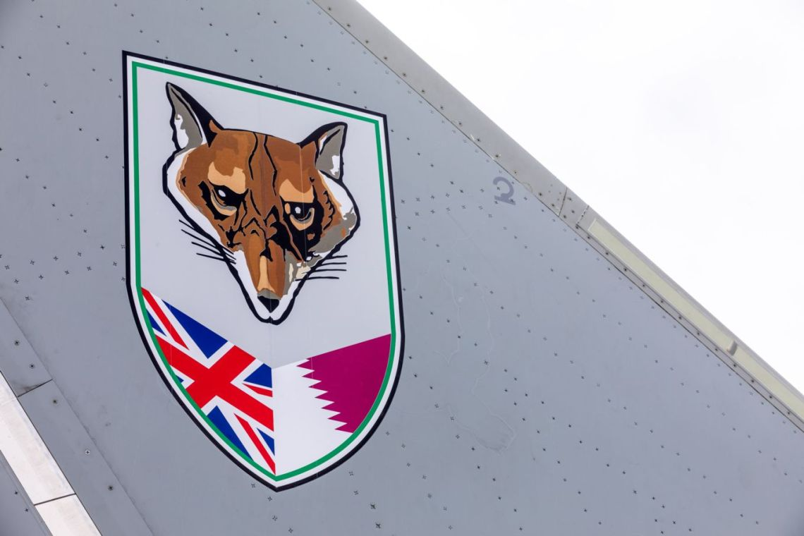 The badge of No. 12 Squadron, a unique joint unit combining Typhoon aircraft operated by the Royal Air Force and the Qatar Emiri Air Force, painted on the tail fins of the unit's Eurofighter Typhoon fighters.