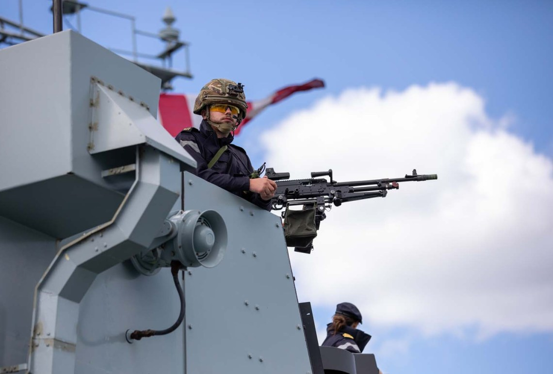 Gunner on bridge wing of HMS Lancaster