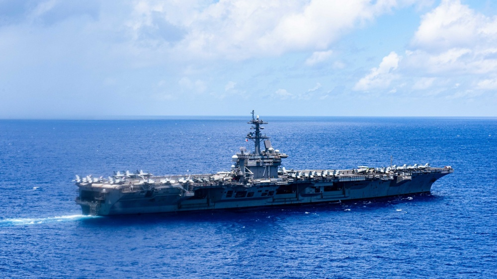 The aircraft carrier USS Theodore Roosevelt transits the Philippine Sea June 17, 2020. The Theodore Roosevelt Carrier Strike Group is on a scheduled deployment to the Indo-Pacific. (U.S. Navy photo by Mass Communication Specialist Seaman Erik Melgar)