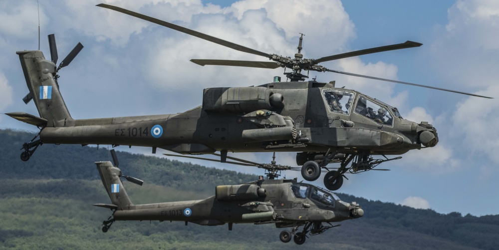 Two AH-64 Apache Helicopters, part of the Greek Army's participation in Operation Strike Back 19, take part in the final live fire exercise of the operation at the Bulgarian Army's Novo Selo Training Area June 19, 2019. (U.S. Army photo by Sgt. Robert Douglas)