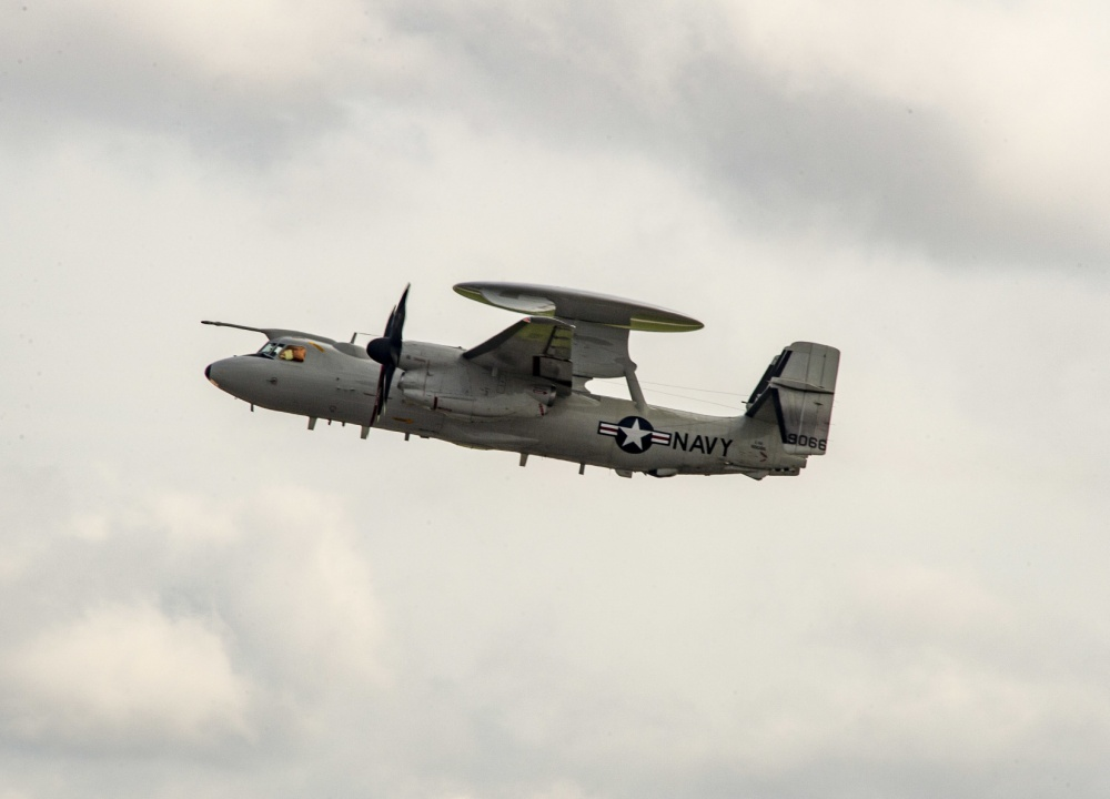"An E-2D Hawkeye prepares to land and be recieved by the ""Greyhawks"" of Carrier Airborne Early Warning Squadron (VAW) 120. (U.S. Navy Photo by Mass Communication Specialist 3rd Class Nikita Custer)"