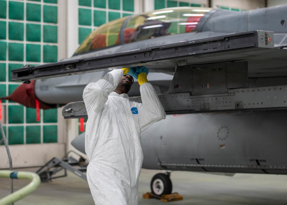 Senior Airman Json Victor, 56th Equipment Maintenance Squadron Low Observable Aircraft Structural Maintenance journeyman, removes leading edge tape on the front of an F-16D Fighting Falcon's wing June 22, 2020, at Luke Air Force Base, Ariz.