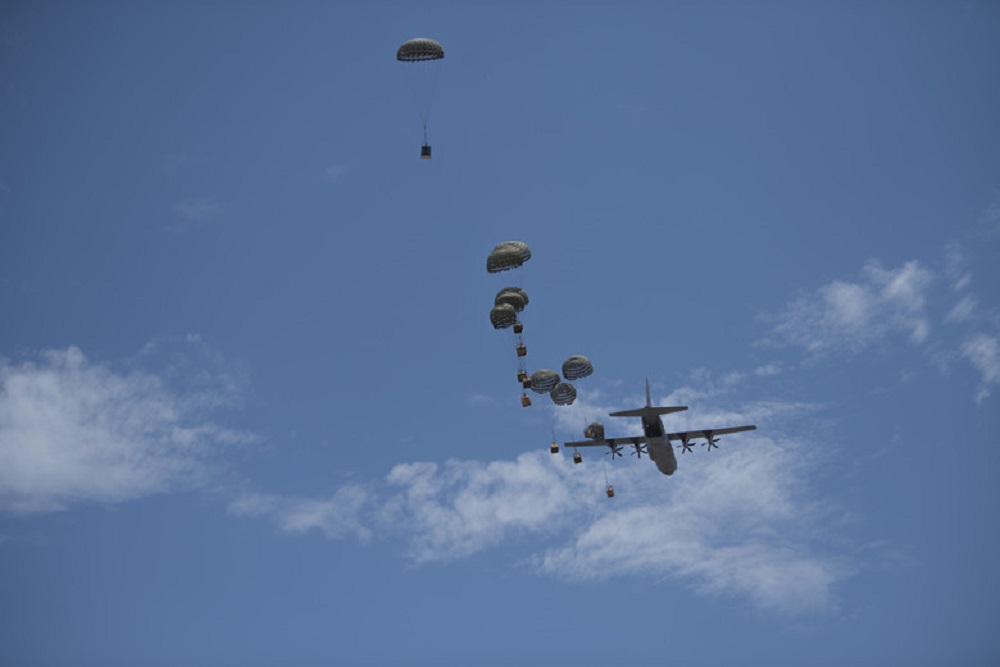 Containerized Delivery System Bundles are dropped from a C-130J Super Hercules aircraft during a Joint Forcible Entry exercise at Dyess Air Force Base, Texas, July 14, 2020. The exercise helped showcase the maintained readiness of the C-130J community despite the ongoing COVID-19 pandemic.