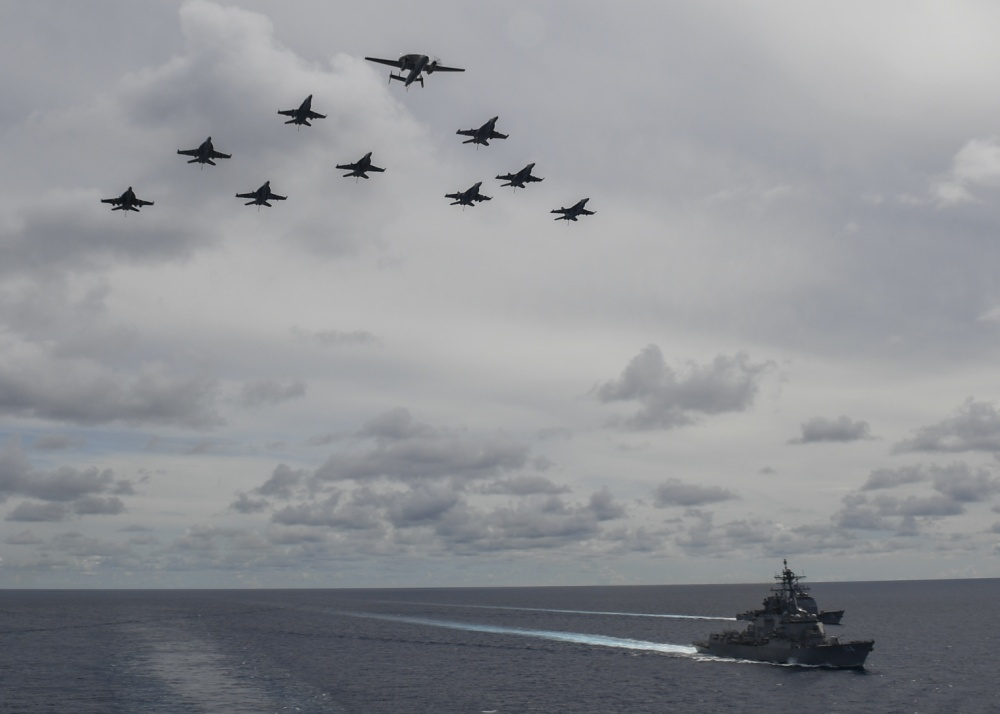 Aircraft from Carrier Air Wing 5 and Carrier Air Wing 17 fly in formation over the USS Nimitz (CVN 68) and USS Ronald Reagan (CVN 76) Carrier Strike Groups.