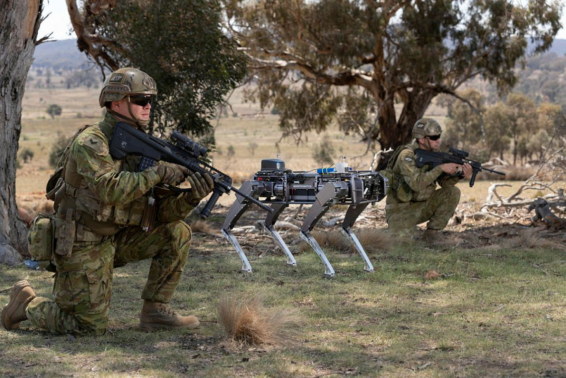 A Ghost Robotics unmanned ground vehicle supports Australian Army soldiers conduct an enemy position clearance during an autonomous systems showcase at the Majura Training Area, Canberra.