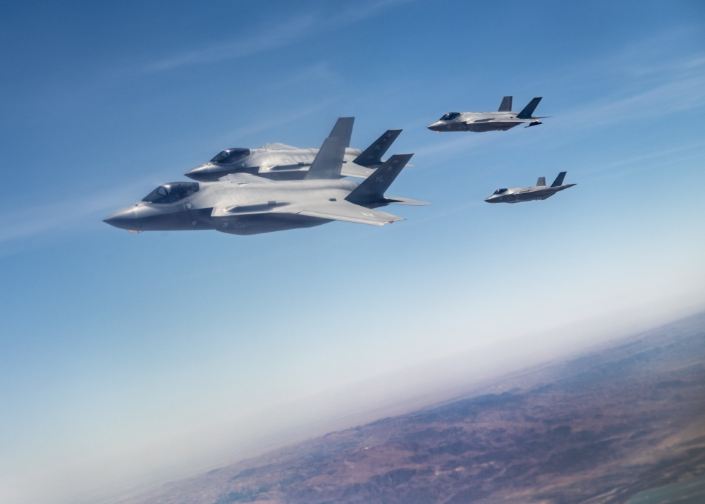 "Israeli Air Force F-35I Lightning II ""Aldir"" and U.S. Air Force 421st Fighter Squadron F-35A Lightning II fly together after refueling from a 908th Expeditionary Refueling Squadron KC-10 Extender during exercise ""Enduring Lightning II"" over Israel Aug. 2, 2020."