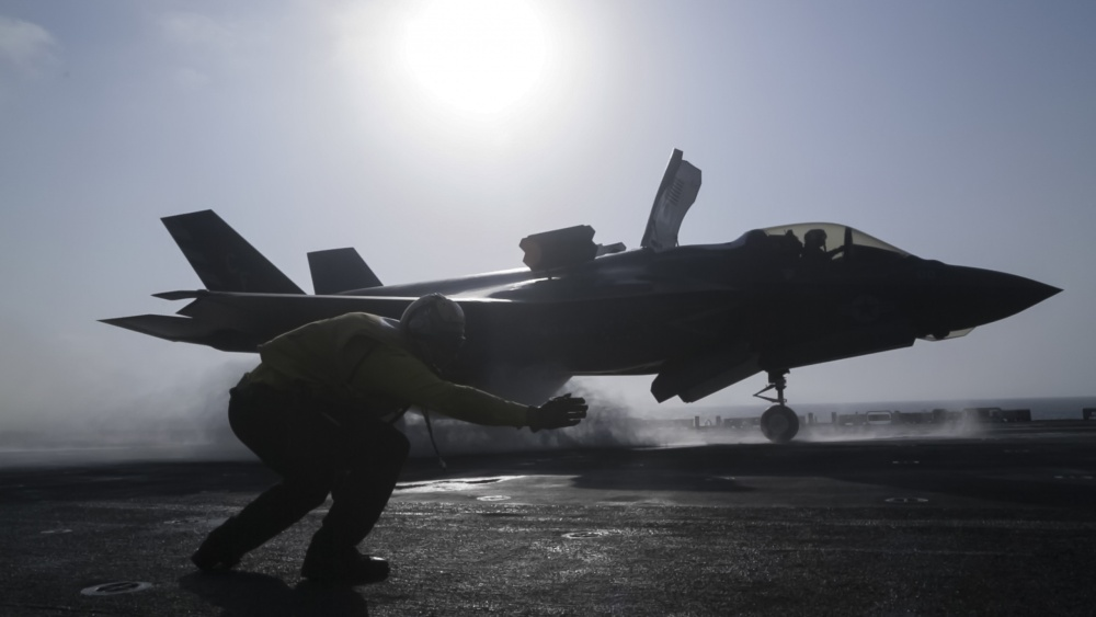 U.S. Navy Petty Officer 1st Class Rey White, an aviation boatswains mate handler with the Essex Amphibious Ready Group (ARG), launches an F-35B Lightning II with Marine Fighter Attack Squadron 211, 13th Marine Expeditionary Unit (MEU), from the Wasp-class amphibious assault ship USS Essex (LHD 2).