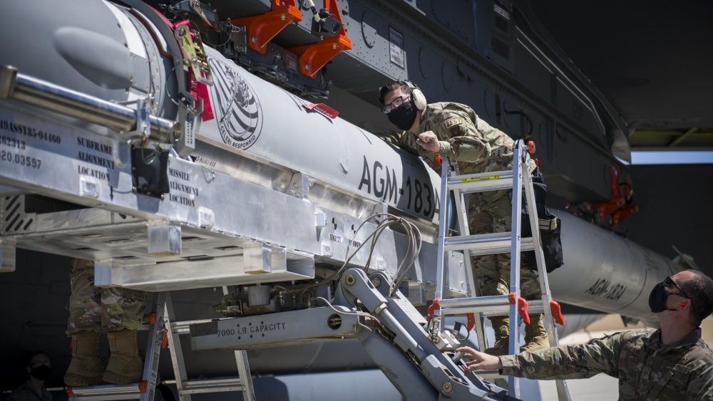 Staff Sgt. Jacob Puente, 912th Aircraft Maintenance Squadron, helps line up the AGM-183A Air-launched Rapid Response Weapon Instrumented Measurement Vehicle 2 as it is loaded under the wing of a B-52H Stratofortress at Edwards Air Force Base, California, Aug. 6.