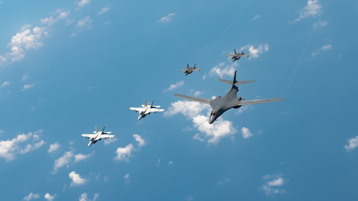 U.S. Navy Carrier Air Wing five F/A-18 Super Hornets, Marine Corps Marine Fighter Attack Squadron 121 F-35 Lightning IIs, all assigned to Marine Corps Air Station Iwakuni, Japan, and a U.S. Air Force 37th Bomb Squadron B-1B Lancer assigned to Ellsworth Air Force Base, S.D., conduct a large-scale joint and bilateral integration training exercise Aug. 18, 2020.