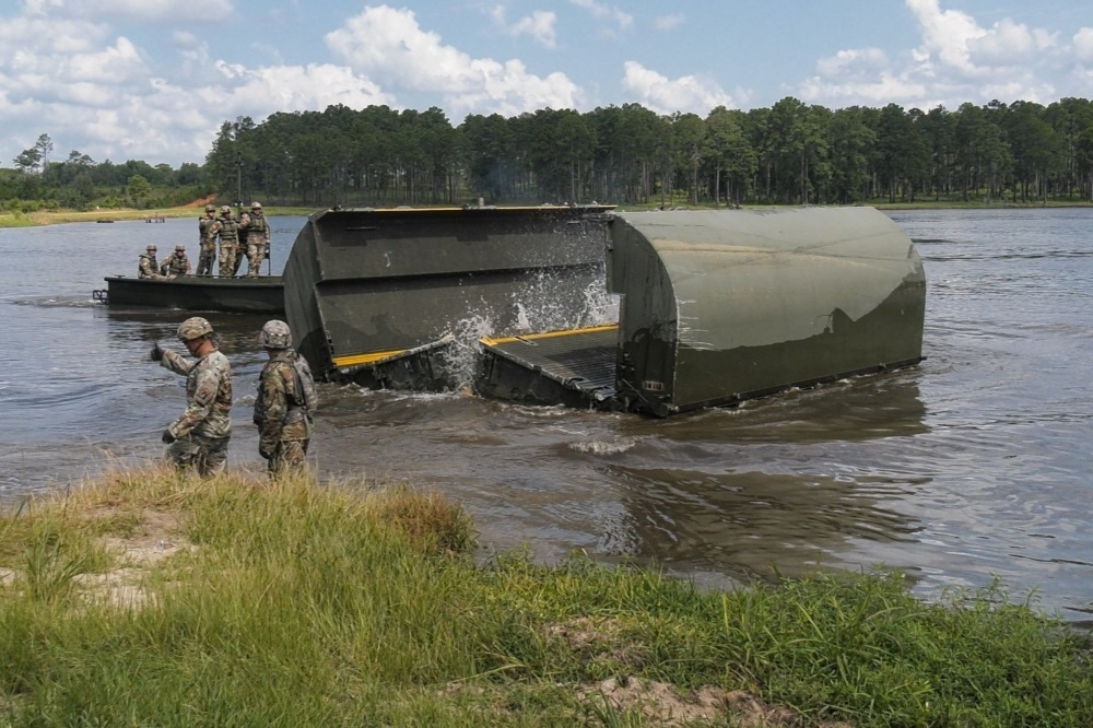 Senior leaders from XVIII Airborne Corps observe after assisting Soldiers from the 361st Multi-Role Bridge Company, 841st Engineer Battalion, 926th Engineer Brigade, launch an interior bay, improved ribbon bridge, July 17, 2020, at Pineview Lake, Fort Stewart, Georgia.