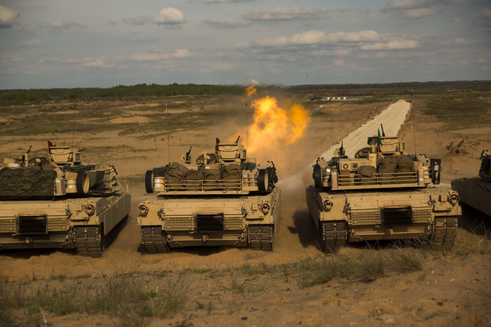 Marines with Alpha Company, 4th Tank Battalion, 4th Marine Division, Marine Forces Reserve, fire from a M1 Abrams tank during Exercise Saber Strike 17 in the Adazi Training Area, Latvia,