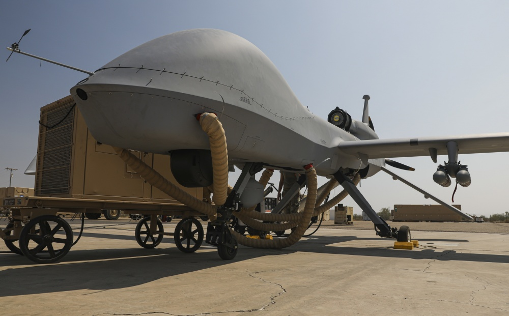 Gearing up for takeoff, an Extended Range / Multipurpose (ER/MP) Unmanned Aircraft System (UAS), is transported to testing zones during Project Convergence 20 commences, at Yuma Proving Ground, Arizona, September 15, 2020. The ER/MP AUS autonomous weapons systems have the ability to actively disperse hellfire missles on enemy targets, without physical U.S. Forces prescence. (U.S. Army photo by (Spc. Jovian Siders, 92nd Combat Camera Company.)