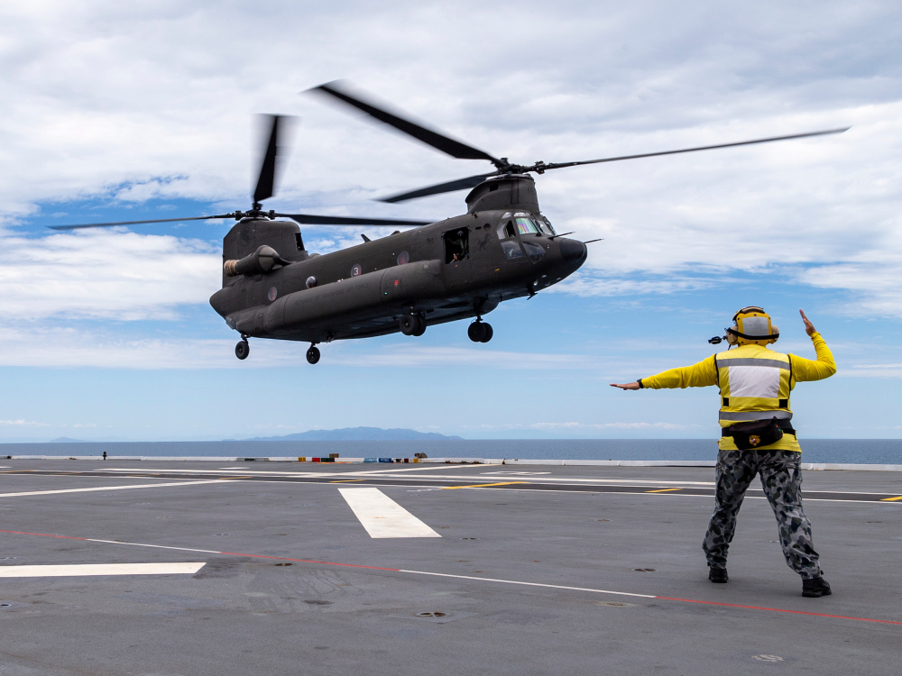 A Republic of Singapore Air Force CH-47 Chinook helicopter lands onboard HMAS Adelaide during Exercise SEA WADER 2020, off the coast of Townsville, Queensland.