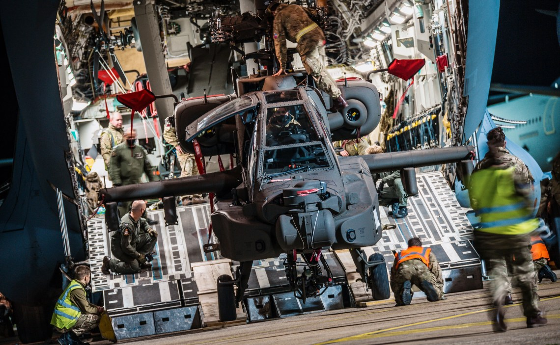 Two new British Army Apache AH-64E Attack Helicopters being off-loaded from Boeing C17 Globemaster at RAF Brize Norton after flying in from Kansas City. (Photographer Cpl Adam Wakefield/ MoD Crown)