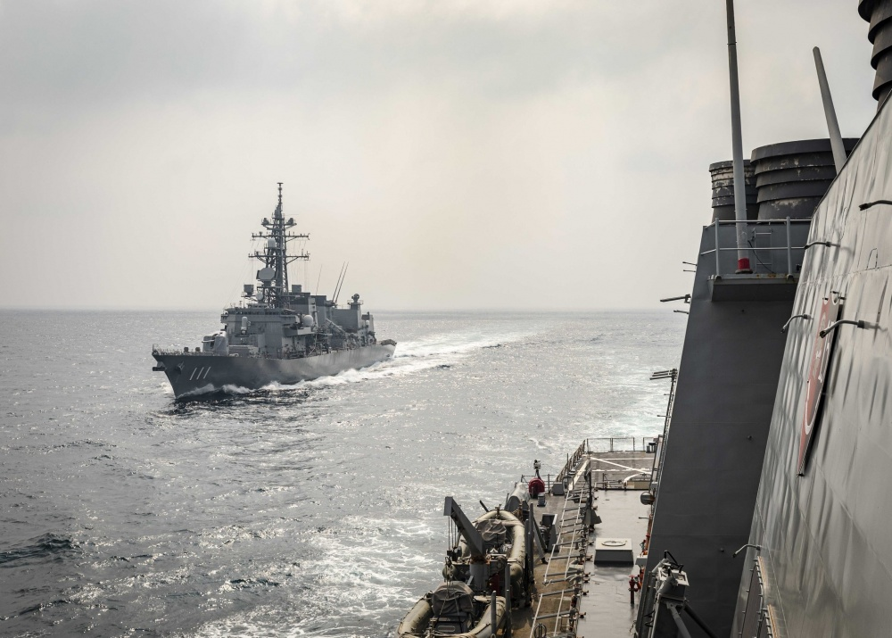 The Takanami-class destroyer JS Onami (JS 111) of the Japan Maritime Self Defense Force prepares to come alongside the Arleigh Burke-class guided-missile destroyer USS John S. McCain (DDG 56) while conducting replenishment-at-sea approaches (RASAPs) as part of Malabar 2020.