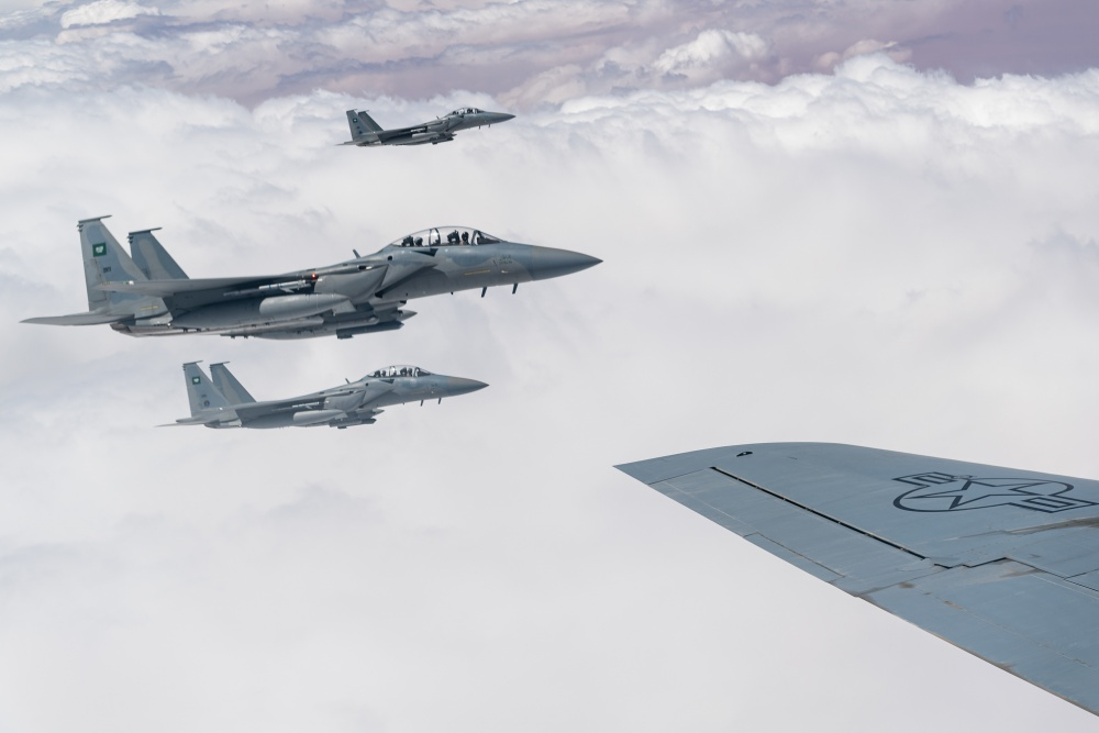 Four Royal Saudi Air Force F-15s fly in formation with U.S. Air Force F-15 Strike Eagles over the U.S. Central Command area of responsibility, Sept 10, 2020.