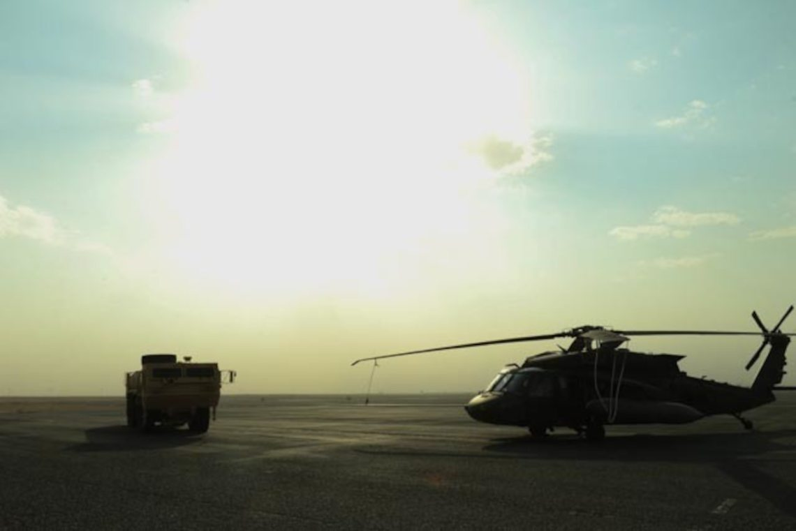 U.S. soldiers with the 28th Expeditionary Combat Aviation Brigade conduct an emergency exercise with the Udairi Landing Zone emergency medical technician team at an airfield in Kuwait, Dec. 16, 2020.