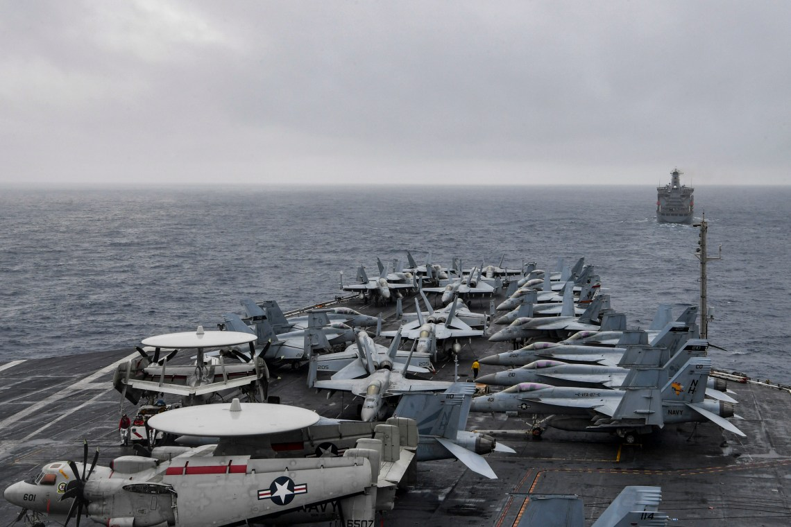 The aircraft carrier USS Theodore Roosevelt (CVN 71) approaches the fleet replenishment oiler USNS John Ericsson (T-AO 194) during a replenishment-at-sea