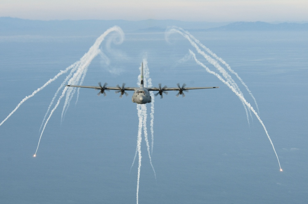 U.S. Air Force C-130J fires flares