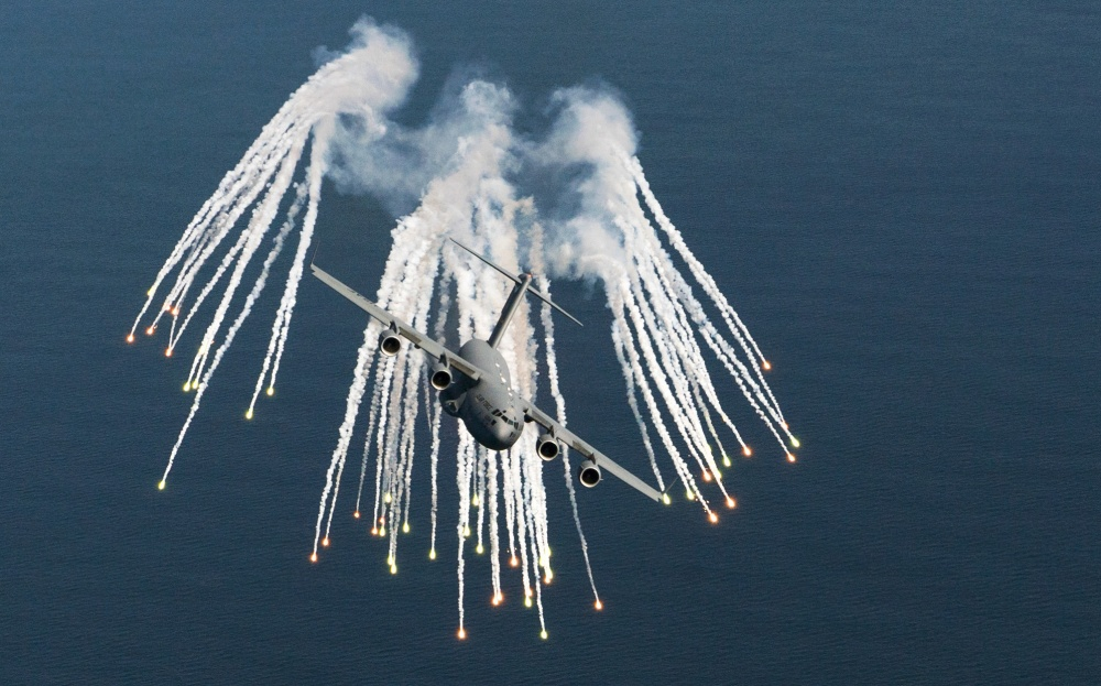 U.S. Air Force C-17 fires flares