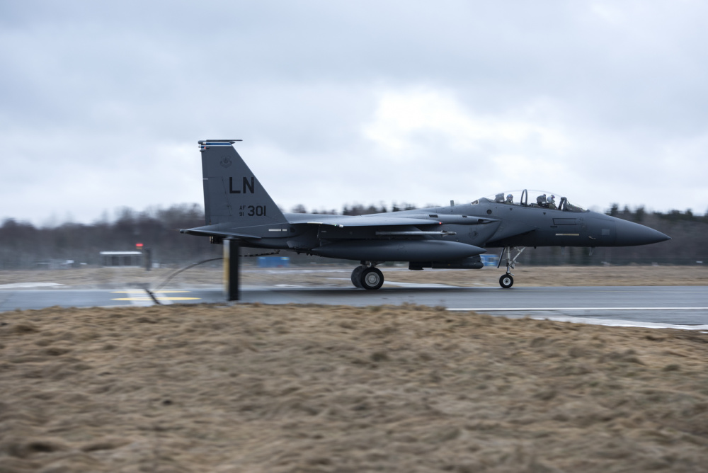 """An F-15E Strike Eagle assigned to the 492nd Fighter Squadron catches the cable of an aircraft arresting system during a Barrier Arresting Kit certification at Ã""""mari Air Base, Estonia, March 17, 2021."""