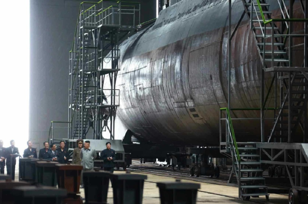 This photo, released by the Korean Central News Agency on July 23, 2019, shows North Korean leader Kim Jong-un (2nd from R) inspecting a newly built submarine.