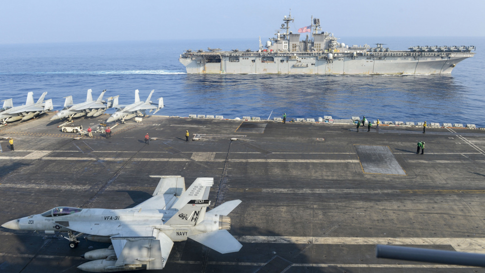 Theodore Roosevelt Strike Group and Makin Island Amphibious Ready Group Conduct Integrated Operations in South China Sea