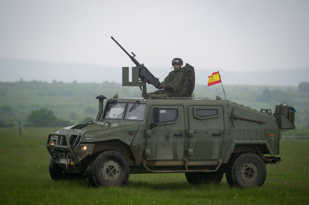 A Spanish Soldier assigned to the BRILAT Brigade mans a machine gun while training tactical vehicle manoeuvring during Exercise Steadfast Defender 2021 in Romania. More than 270 Spanish troops deployed to Romania in support of the exercise.