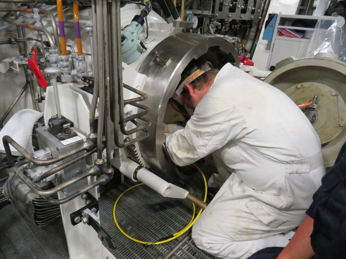 Engineers/crew preparing 'Mod-1' Spearfish torpedo for trial on-board Audacious