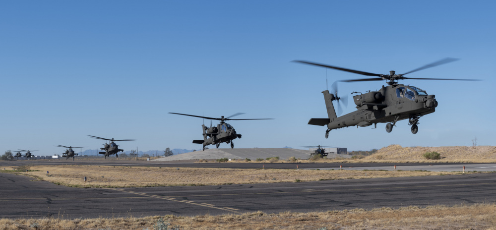 A group of AH-64E version 6 Apache helicopters depart the Boeing manufacturing facilities at Mesa, Ariz. 13 January bound for Joint Base Lewis-McChord (JBLM), Wash. The aircraft will be delivered to the 1-229th Attack Reconnaissance Battalion. With the fielding of these aircraft, the 1-229th ARB, becomes first operational unit to add the Apache V6 aircraft to its inventory. (Photo Courtesy Boeing Mesa)
