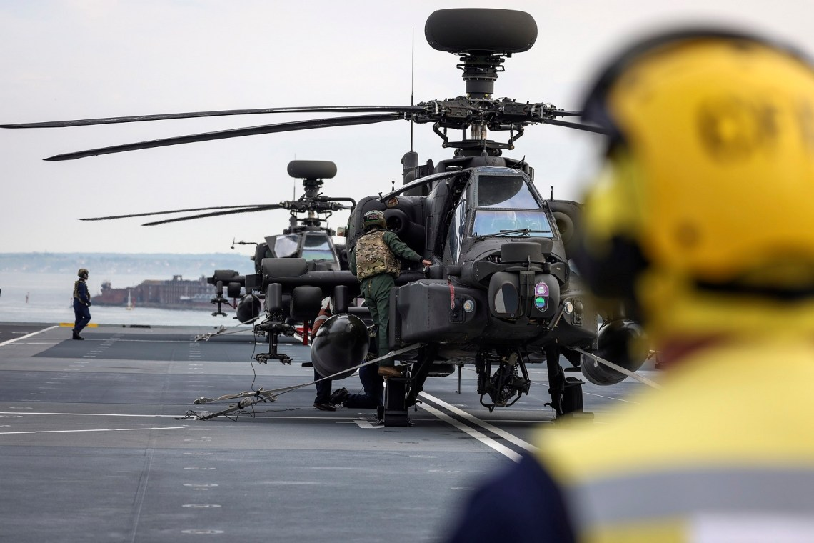 Three Apache helicopters from 656 Squadron, 4 Regiment Army Air Corps land on HMS Prince Of Wales flight deck.