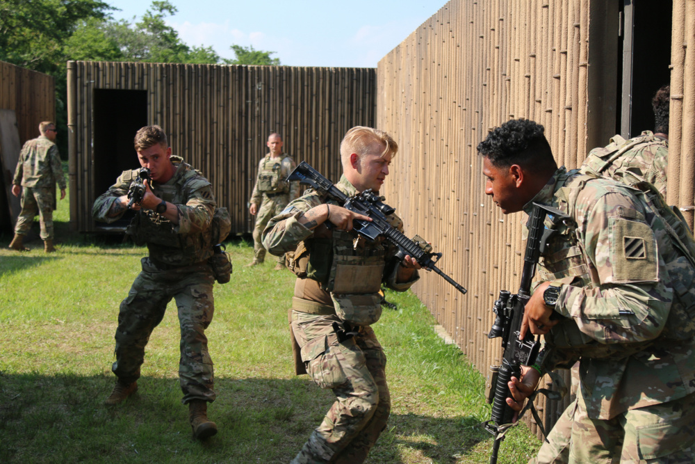 A group of four Soldiers assigned to 1st Battalion, 28th Infantry Regiment, 3rd Infantry Division, breach and enter a building while practicing military operations in urban terrain on Camp Fuji, Japan, June 10, 2021