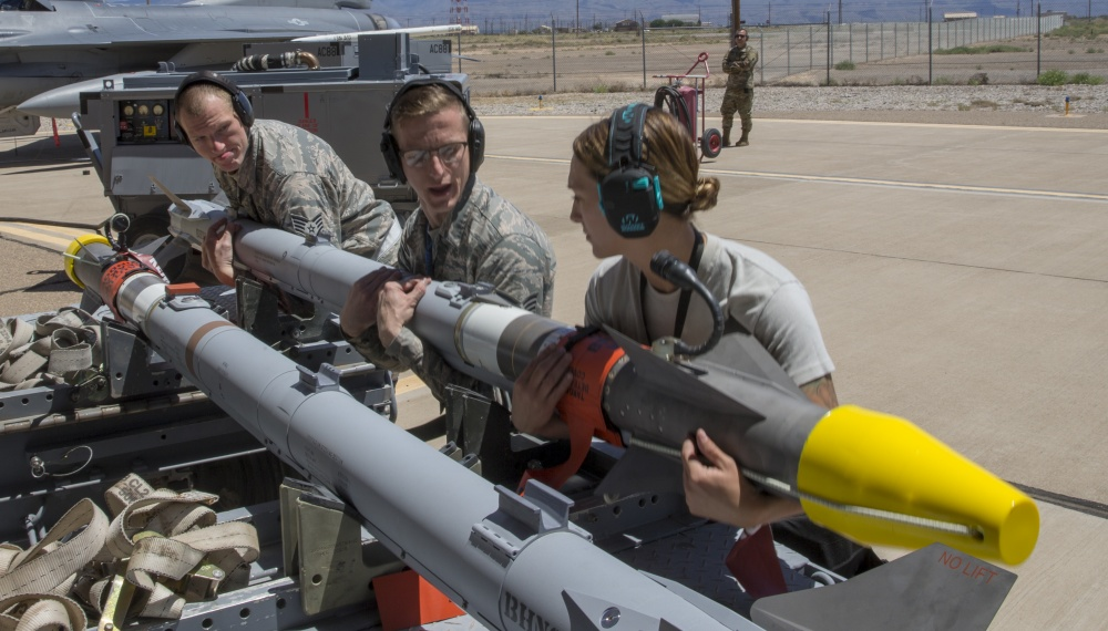 Members of the Eglin AFB 96 Maintenance Group Weapons Standardization team prepare the AIM-9X Sidewinder missile that will be used during a live fire test at Holloman Air Force Base, New Mexico, Apr. 23, 2019. The AIM-9X is the most advanced infrared-tracking, short-range, air-to-air and surface-to-air missile in the world.
