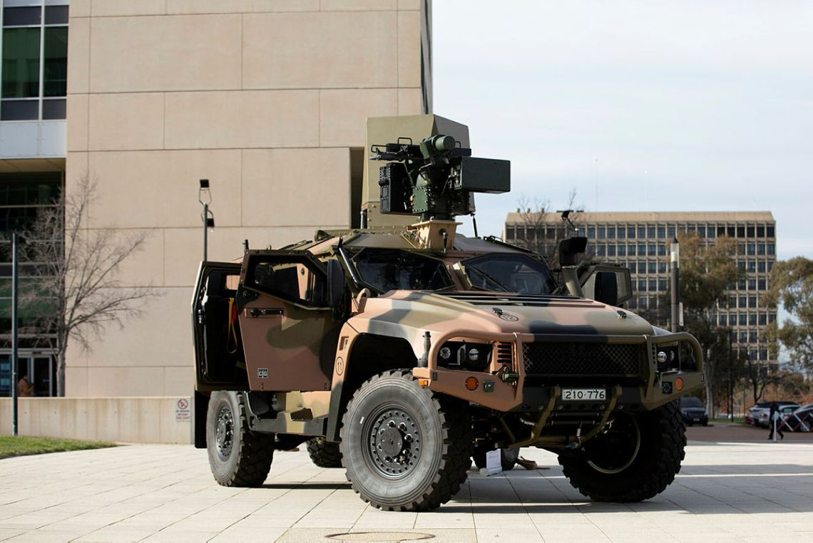 An Australian Army Hawkei Protected Mobility Vehicle with a mock-up of a CEA Technologies Tactical Radar and an Electro-Optic Systems RS400 Mk2 Remote Weapon System on display at Russell Offices, Canberra.