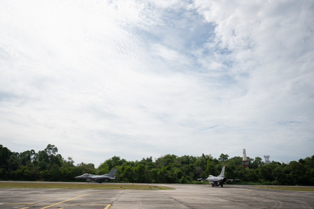 U.S. Air Force F-16 Fighting Falcons taxi to the runway during Cope West 21, at Roesmin Nurjadin Air Force Base in Pekanbaru, Riau, Indonesia, June 18, 2021.