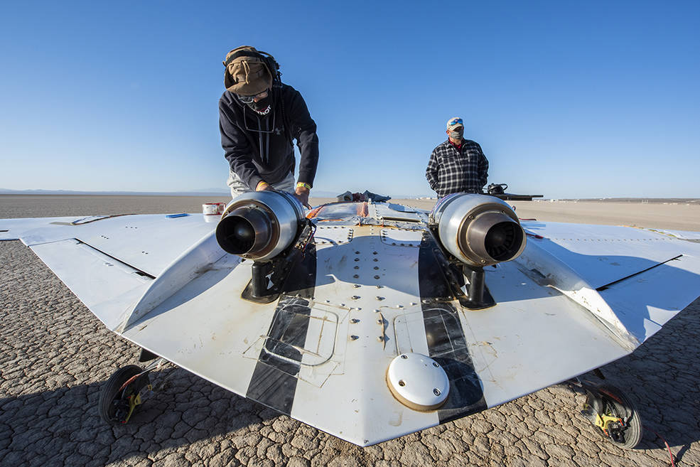 The X-56B remotely piloted aircraft ground crew prepares the aircraft to begin a new flight series. The flight was April 19 at NASA's Armstrong Flight Research Center in Edwards, California, with partner Northrop Grumman.