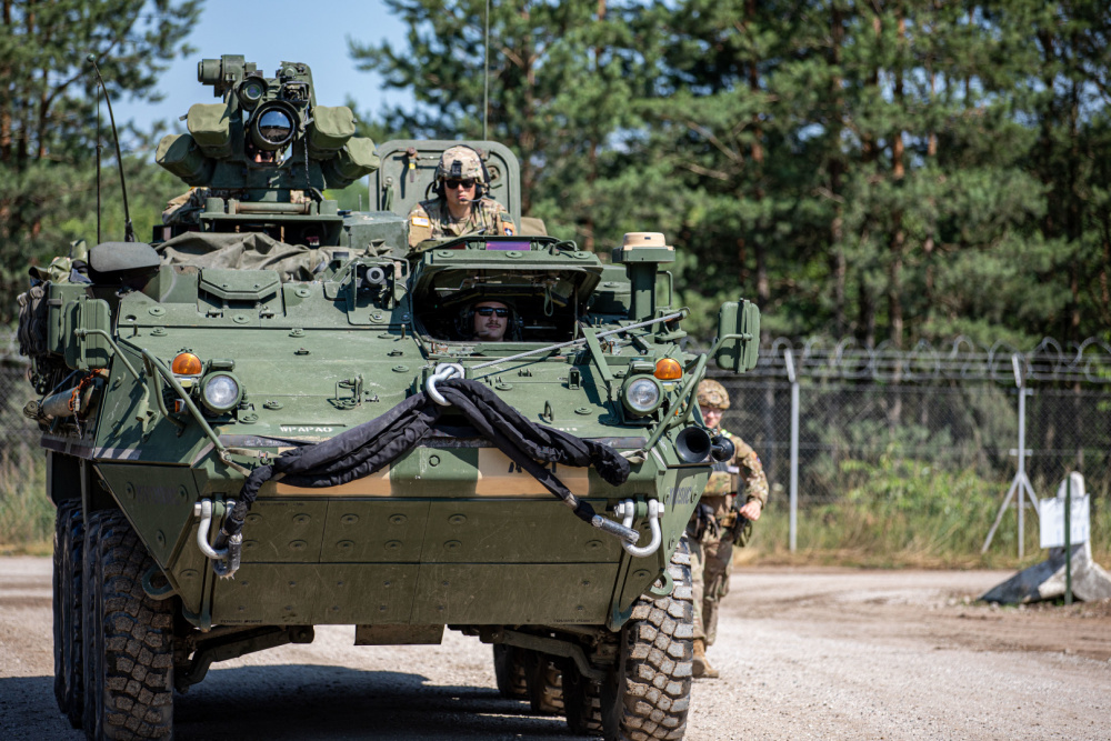 """U.S. Army Soldiers with 3rd Battalion, 161st Infantry Regiment, move an Infantry Carrier Vehicle (ICV) """"Stryker"""" into staging position during a deployment readiness exercise in Bemowo Piskie Training Area, Poland, July 1, 2021."""