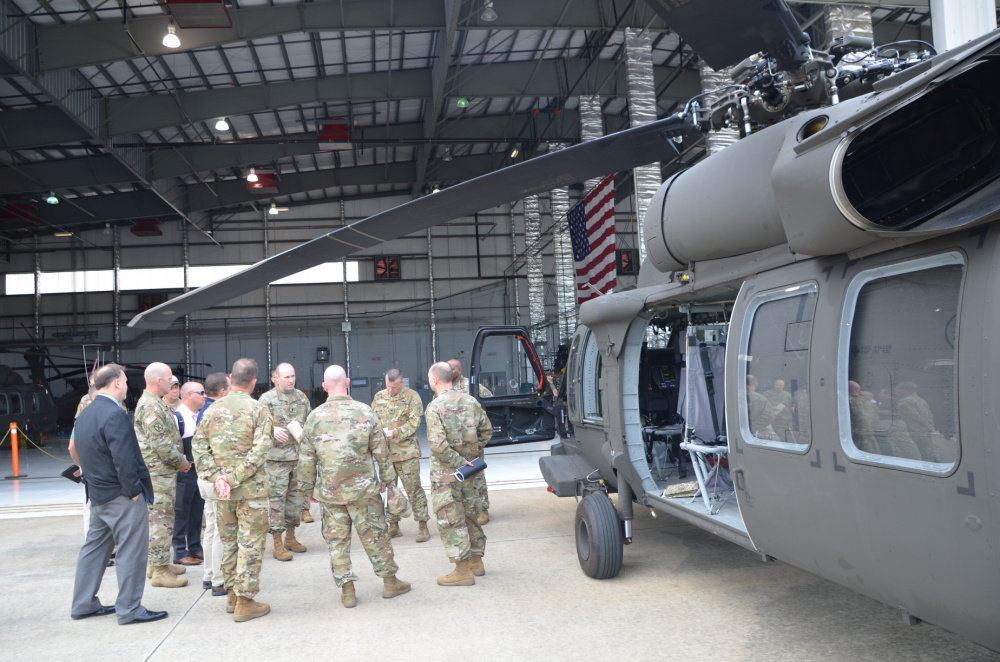 Lt. Col. Dan Thetford, center, Product Manager for the UH-60V Black Helicopter, discusses the aircraft capabilities with several State Aviation Officers at the Huntsville, Al. International Airport July 13.
