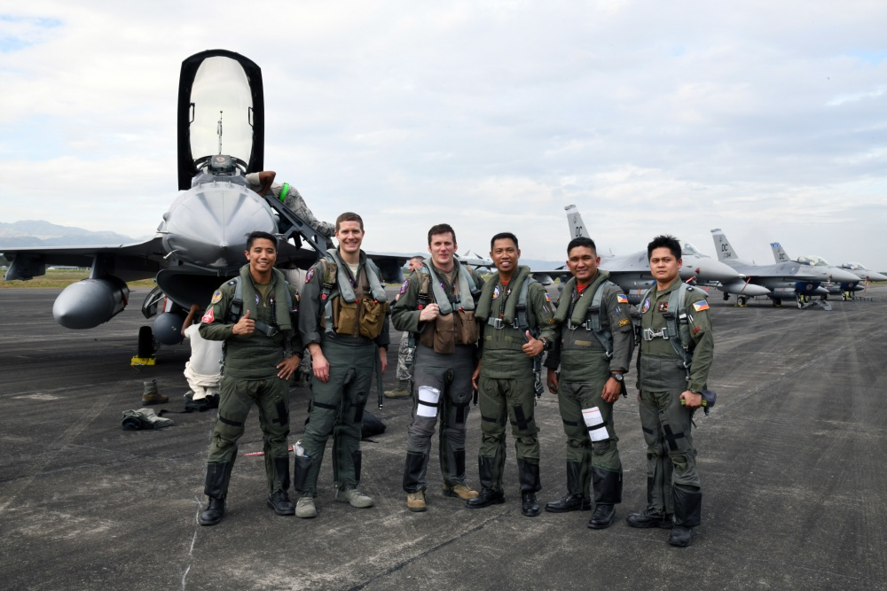 U.S. Air Force F-16 Fighting Falcon pilots pose alongside Philippine Air Force FA-50 pilots after flying a bilateral training sortie during Bilateral Air Contingent Exchange-Philippines (BACE-P) at Cesar Basa Air Base, Philippines.