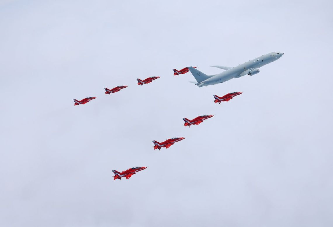 THE Royal Air Force's new submarine-hunter aircraft has flown in formation with the Red Arrows for the first time.