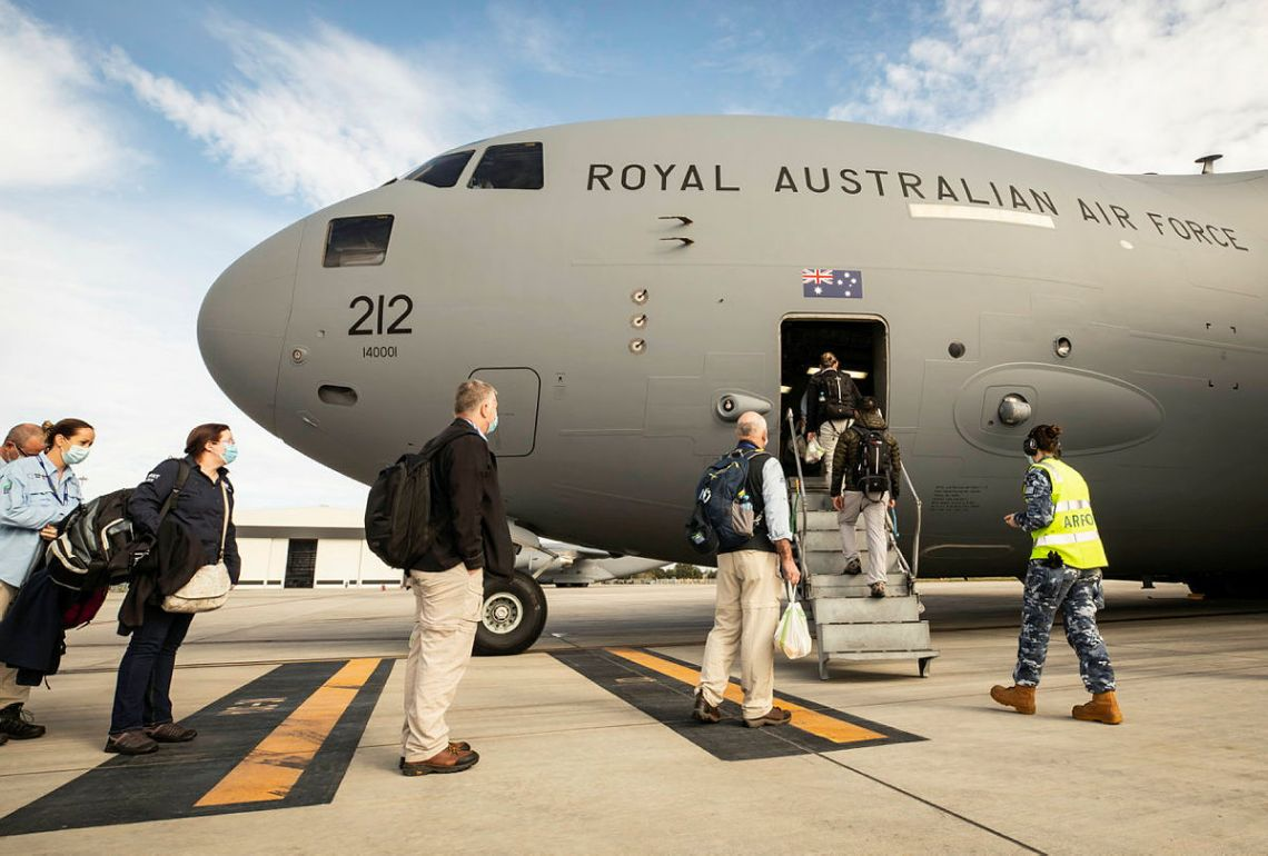 Australian Medical Assistance Team (AUSMAT) members board a No. 36 Squadron C-17A Globemaster III aircraft at RAAF Base Amberley, headed to Fiji in response to a COVID-19 outbreak across the nation.