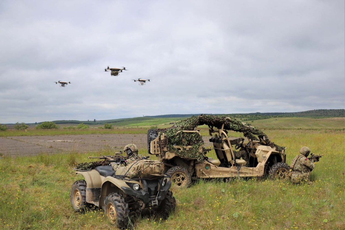 Royal Marines carry out experimental exercises with swarms of drones