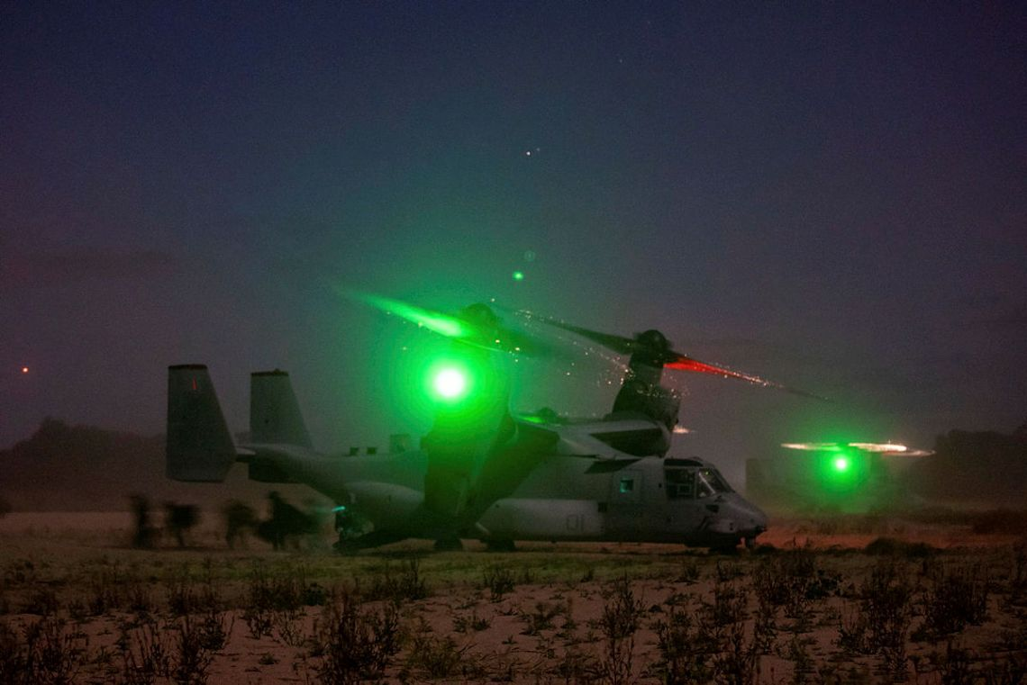 US Marines from 1st Battalion, 7th Marines, disembark a US MV-22B Osprey during an airfield assault serial near Bowen in Queesnland, on Exercise Talisman Sabre 2021.