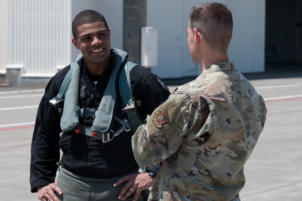 """U.S. Air Force Maj. Josiah """"Sirius"""" Gaffney, PACAF F-16 Demonstration Team pilot, talks to Col. Timothy Murphy, 35th Fighter Wing vice commander, after flying a demo routine at Misawa Air Base, July 21, 2021."""