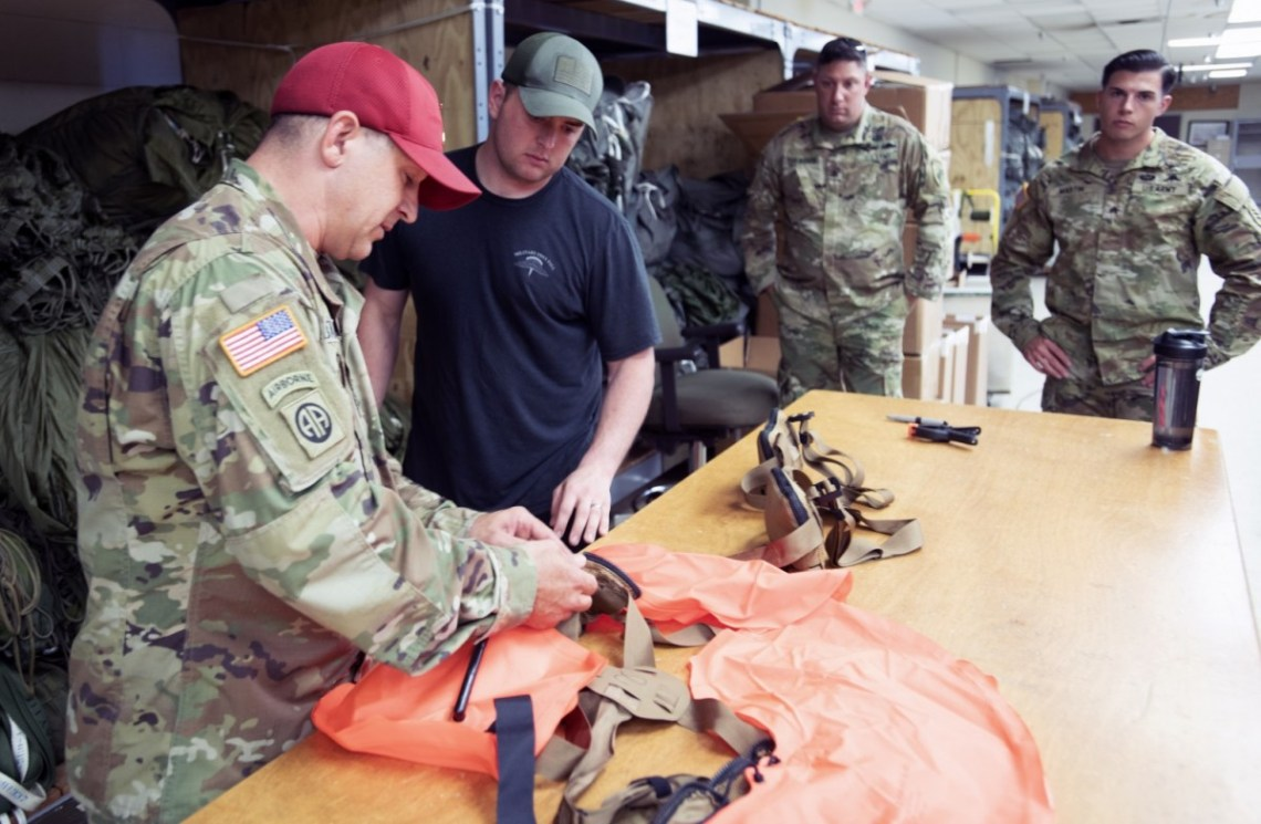 New Equipment Trainers from Fort Lee, Virginia instruct maintainers from across the airborne community on the proper maintenance and packing of the Parachutist Flotation Device (PFD).