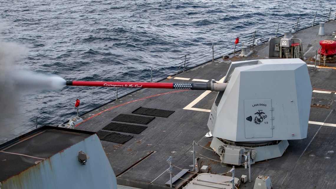 The Arleigh Burke-class guided-missile destroyer USS Rafael Peralta (DDG 115) fires its 5-inch gun during exercise Pacific Vanguard 2021.