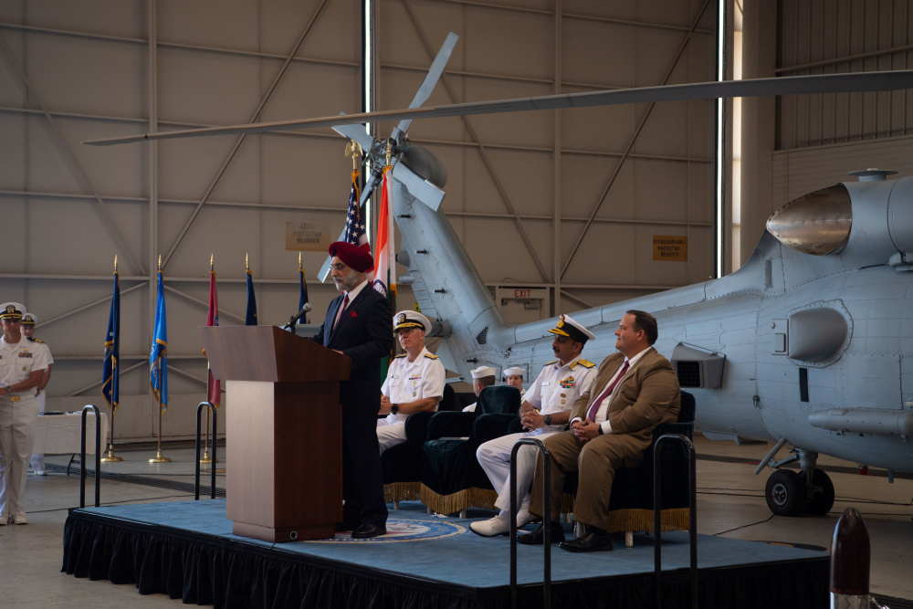 Ambassador Taranjit Singh Sandhu, Indian Ambassador to the U.S., delivers remarks during a ceremony in which the Indian Navy inducted its first two MH-60R Seahawks from the U.S. Navy at Naval Air Station North Island on Friday, July 16.